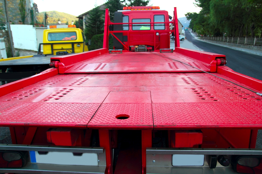This is a picture of a flatbed towing service.