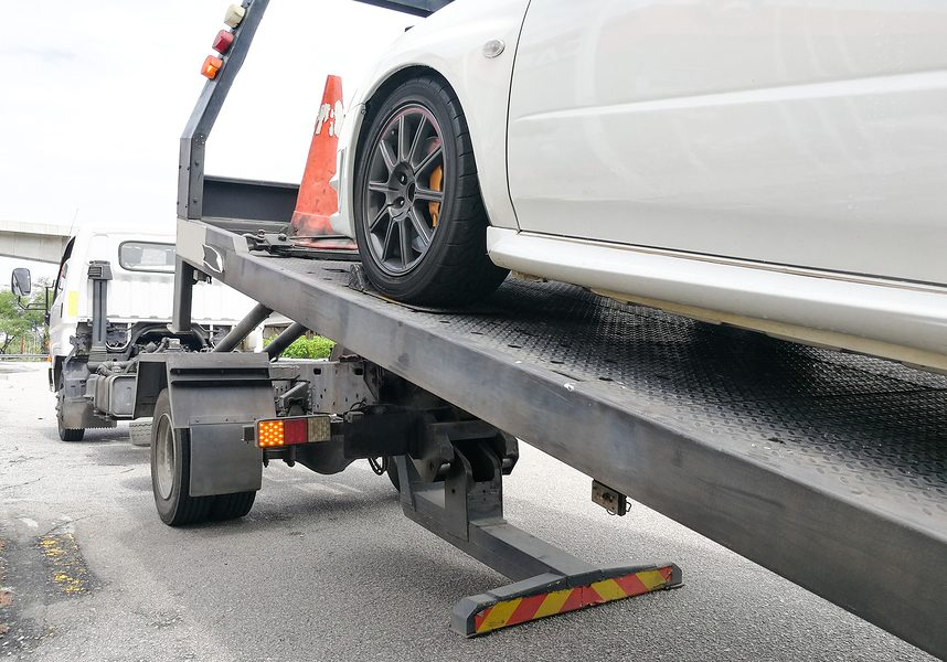 This is a picture of a flatbed towing.